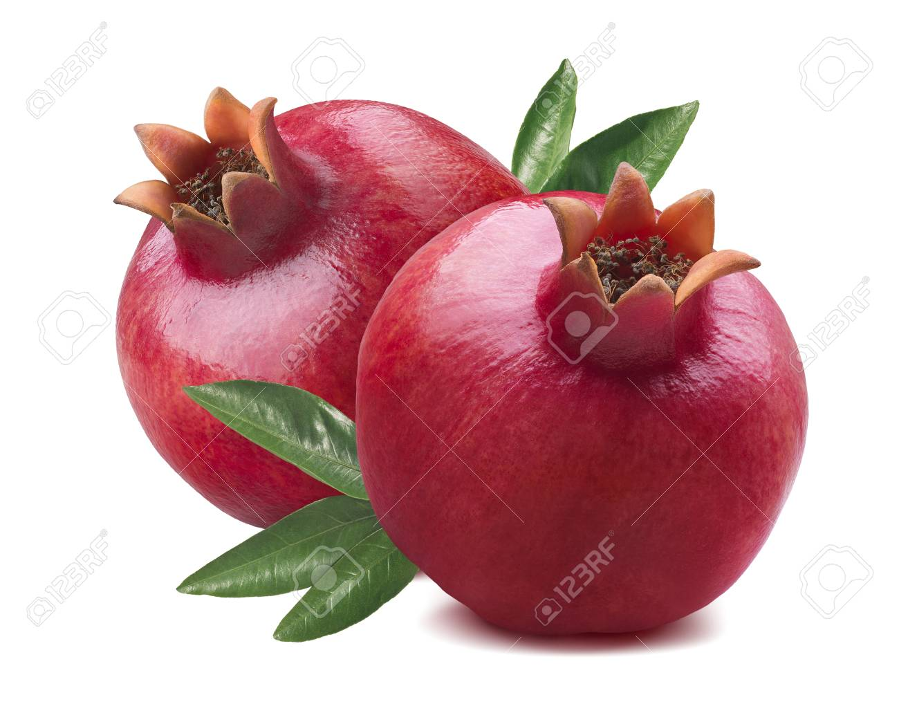 2 fresh whole pomegranates with leaves isolated on white background as package design element - 63750608