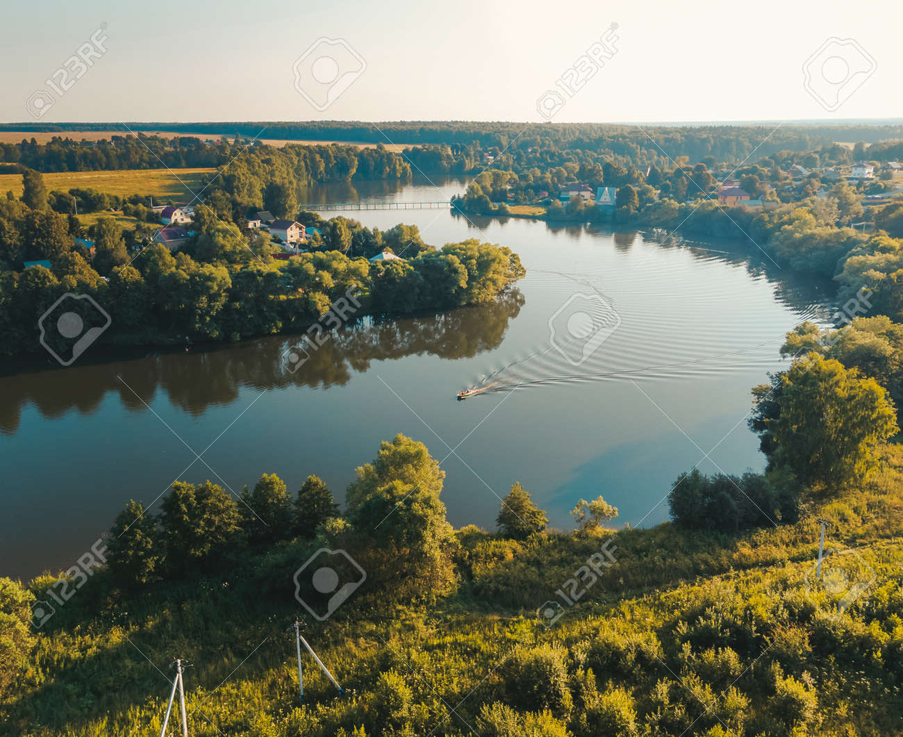 Aerial view of motor boat on river. Drone photography. Summer time. - 171661839