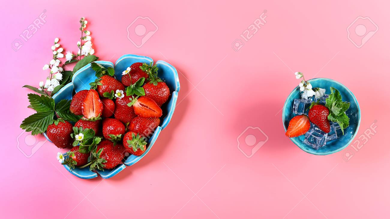 Two blue plates of fresh strawberries ice mint pink flowers stock photo two blue plates of fresh strawberries ice mint pink flowers isolated on pink background with copy space view from above set mightylinksfo