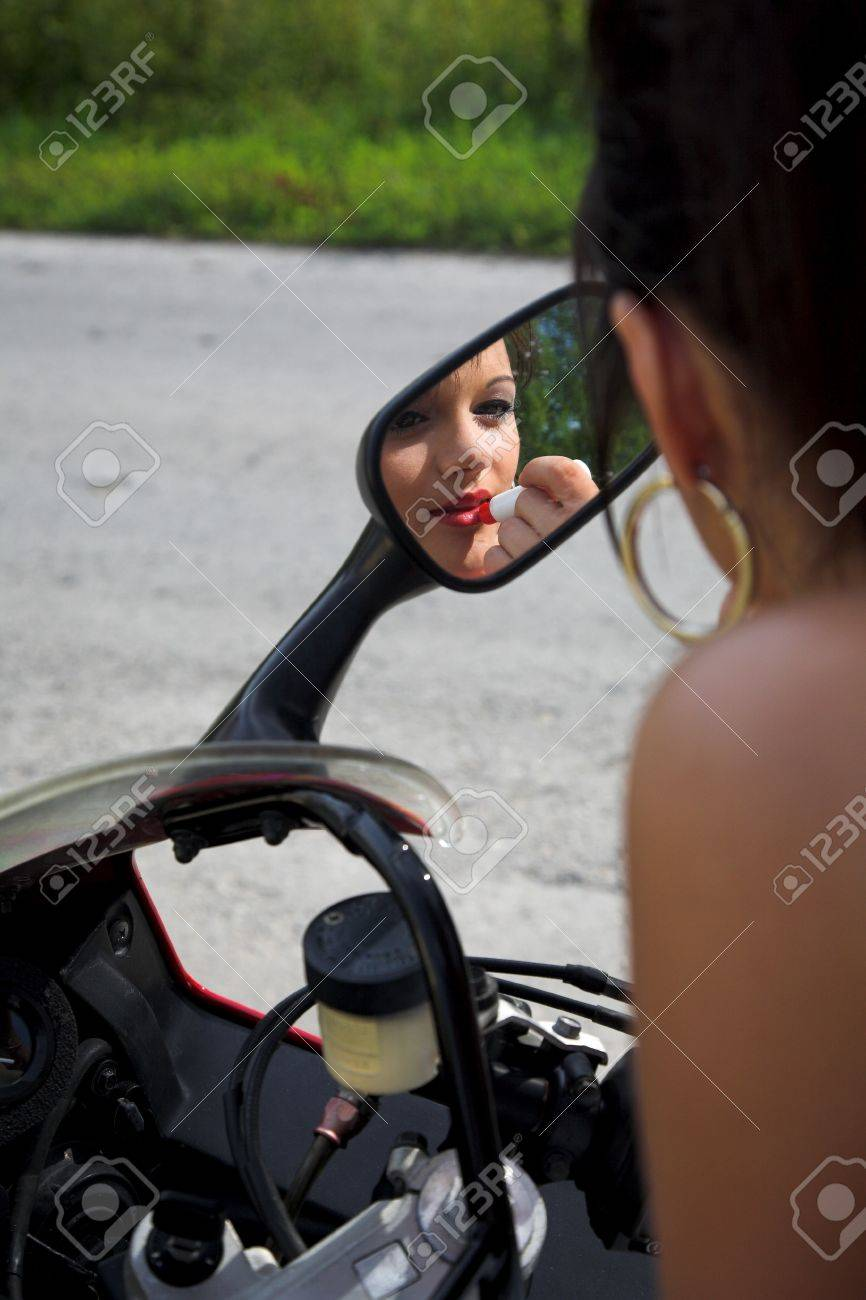 young beauty girl with motorbike on the road Stock Photo - 4265072