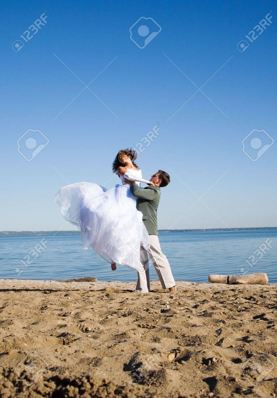 happy couple on the beach Stock Photo - 7968792