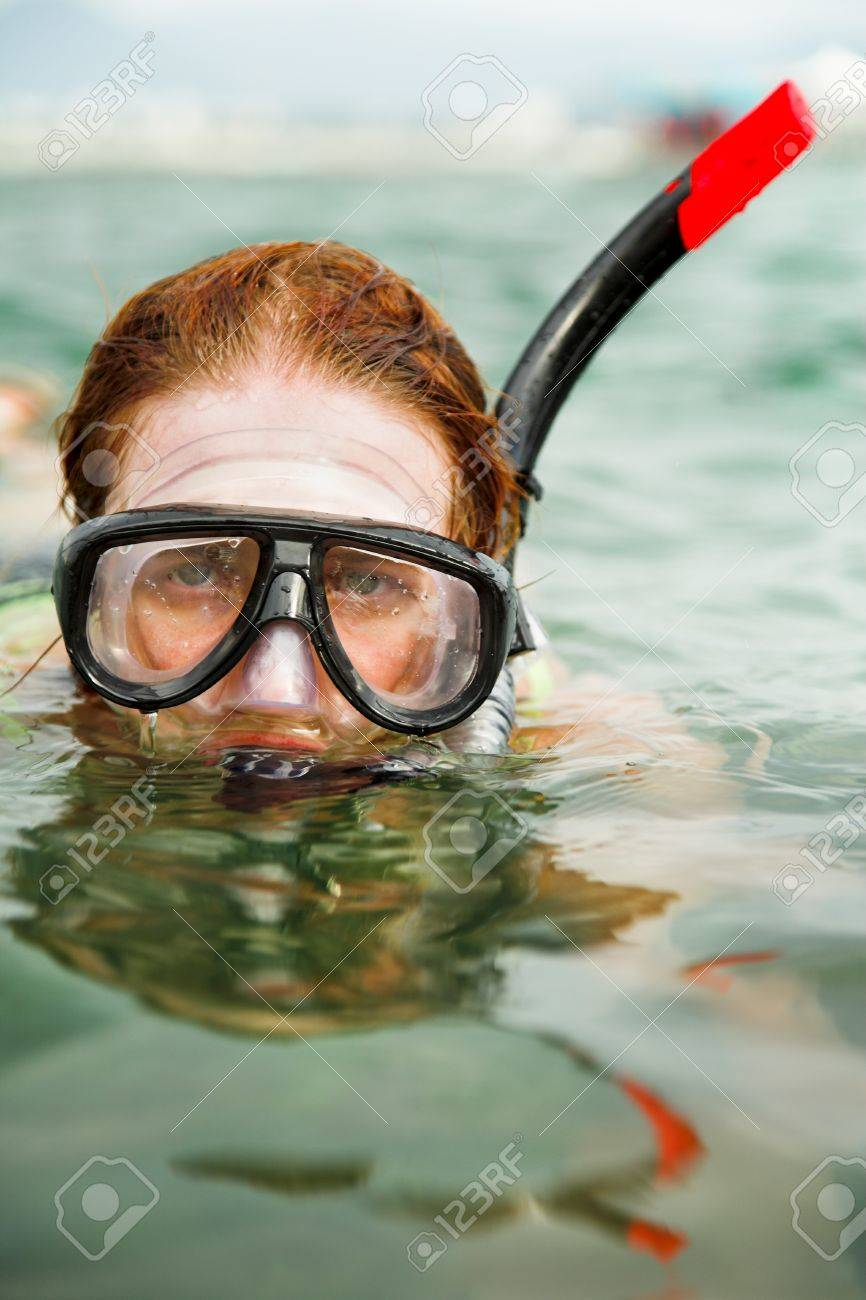 young beauty woman swimming in diving mask Stock Photo - 8696822