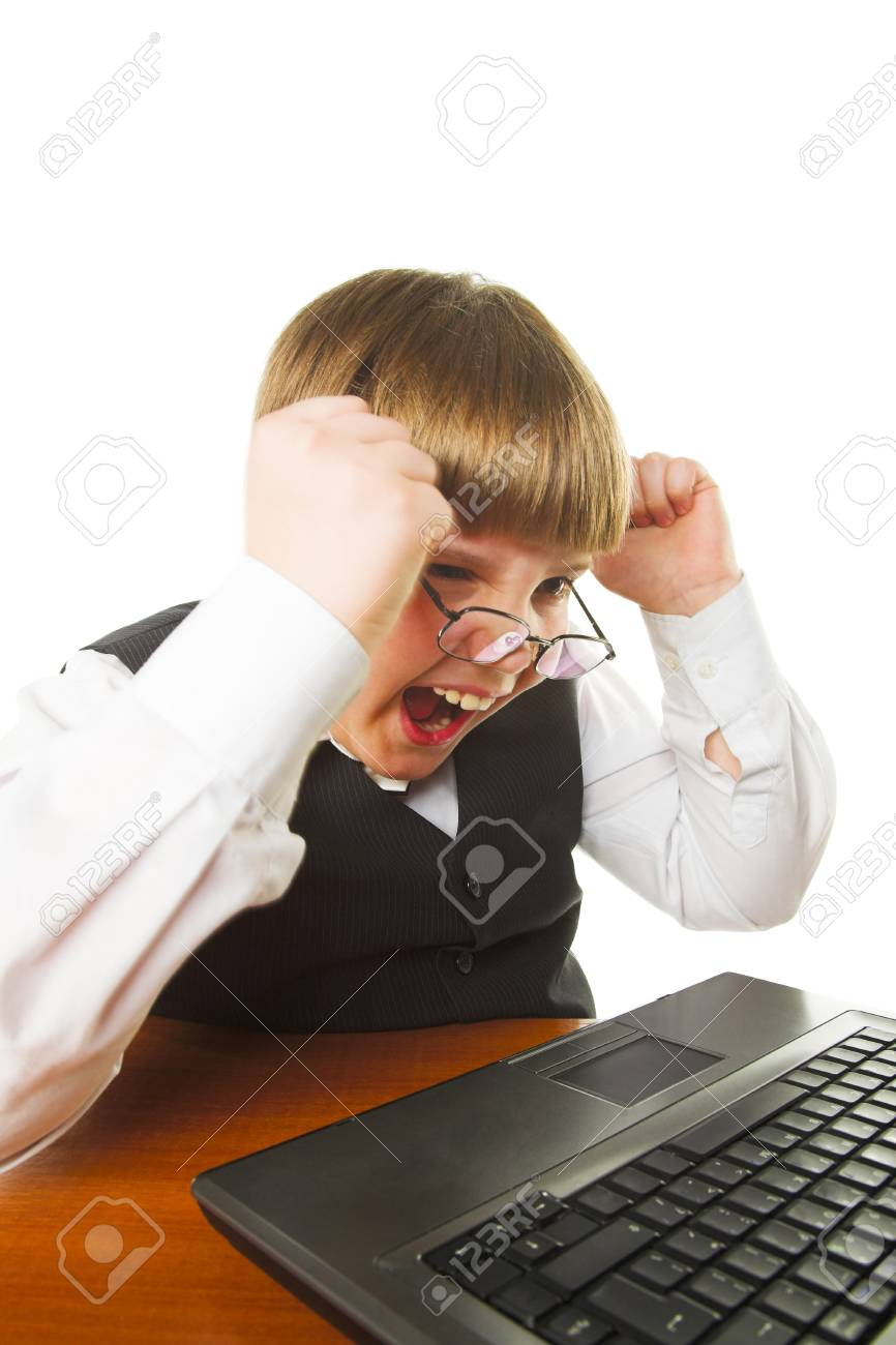 aggressive boy with laptop isolated on white Stock Photo - 9399123