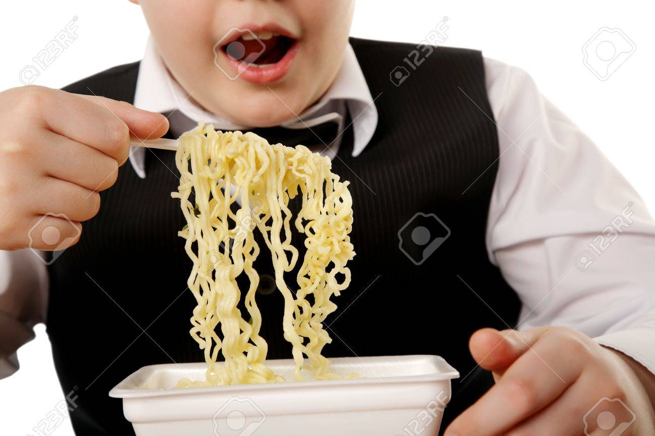 boy eating chinese instant noodles isolated on white - 9999750