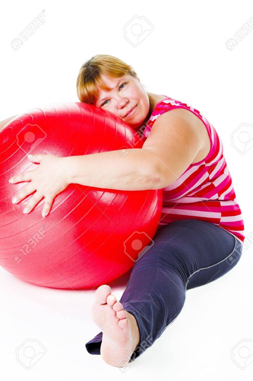 tired fat woman with big red gymnastic ball Stock Photo - 11230916