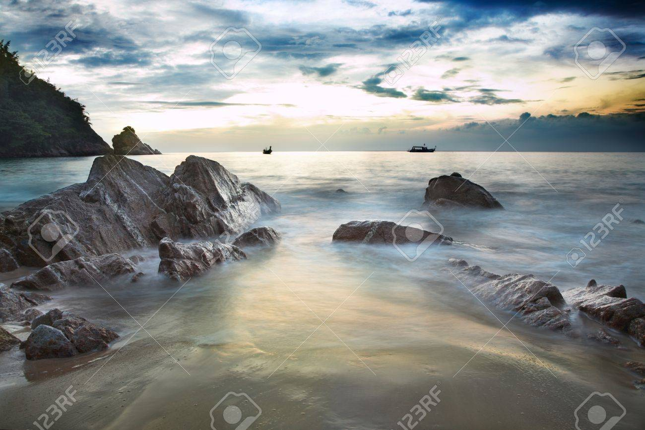 sea landscape with cloudy sky and big stones - 11410726
