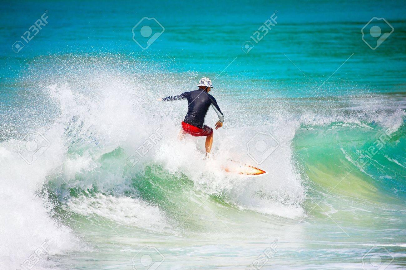 Man Surfed on Big Blue Ocean Wave - 11417836