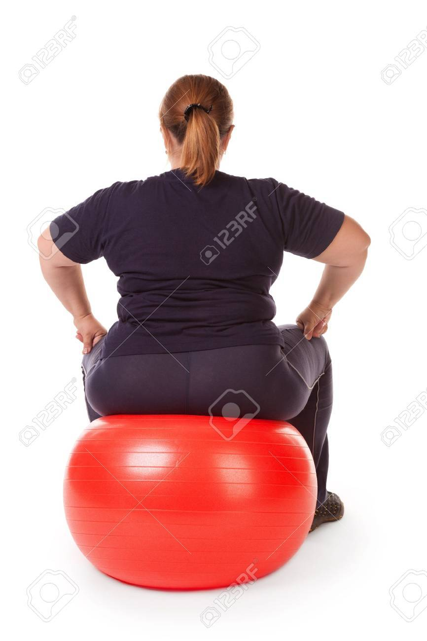 fat woman with big red gimnastic ball - 12184677