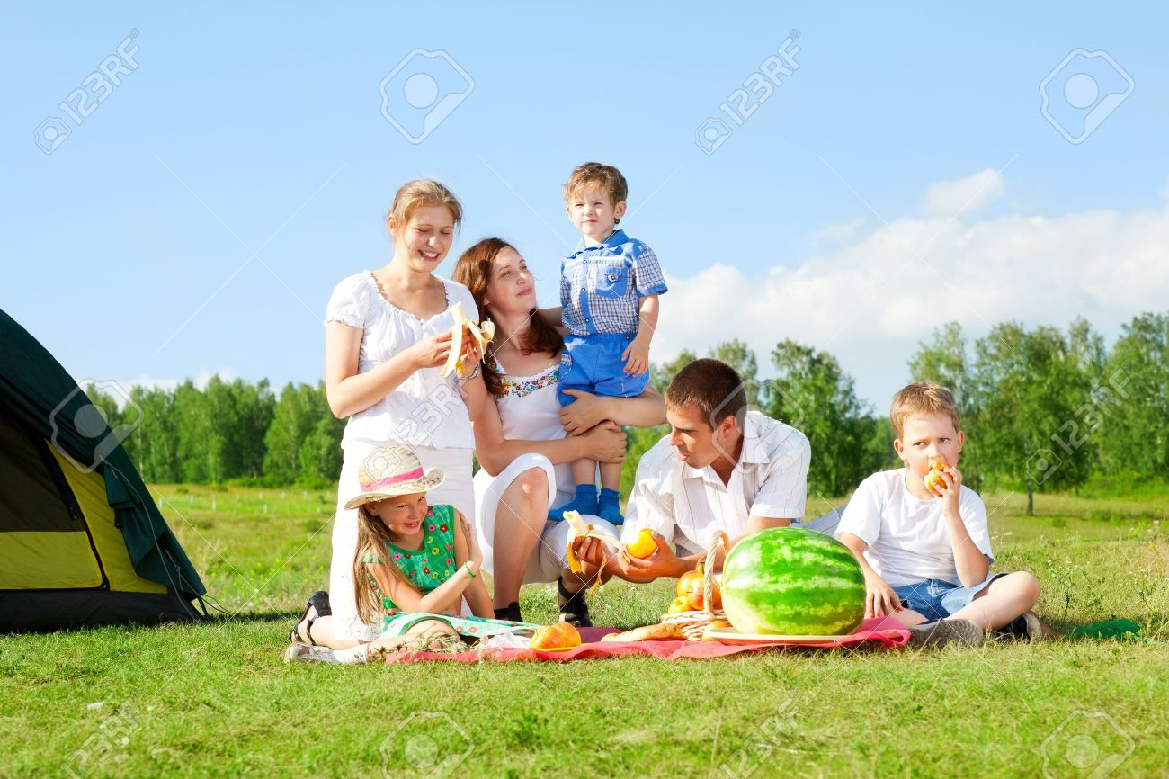 happy family have a picnic outdoor - 12763913