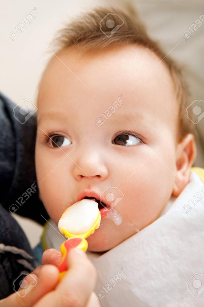 Little boy eating baby food Stock Photo - 12775483