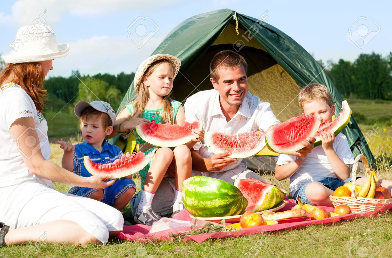 happy family have a picnic outdoor - 13791942