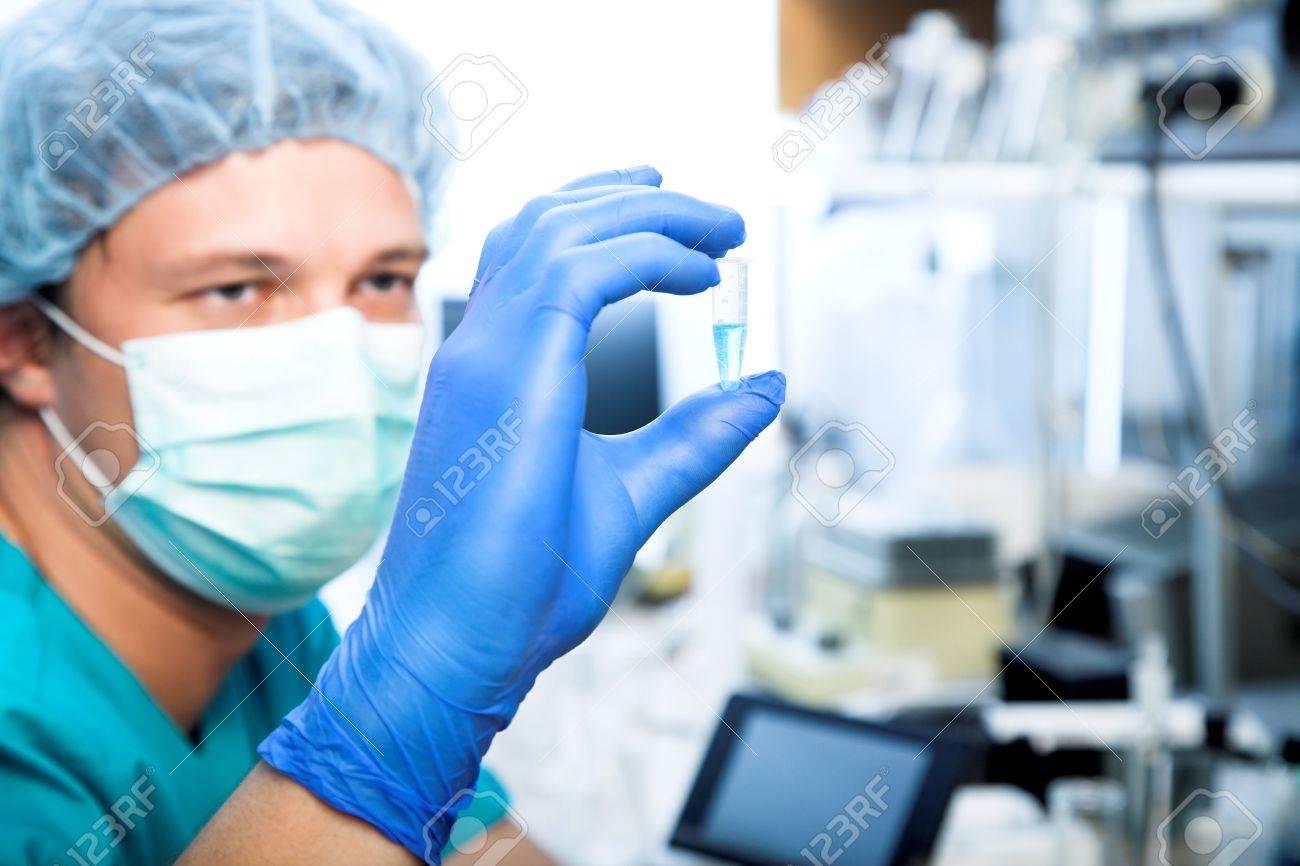 scientist doing DNA test in modern laboratory - 16334881