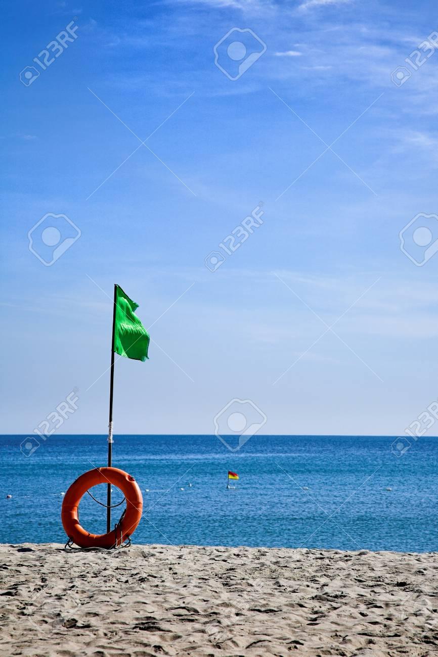 Beach green flag good weather wind Stock Photo - 25465331