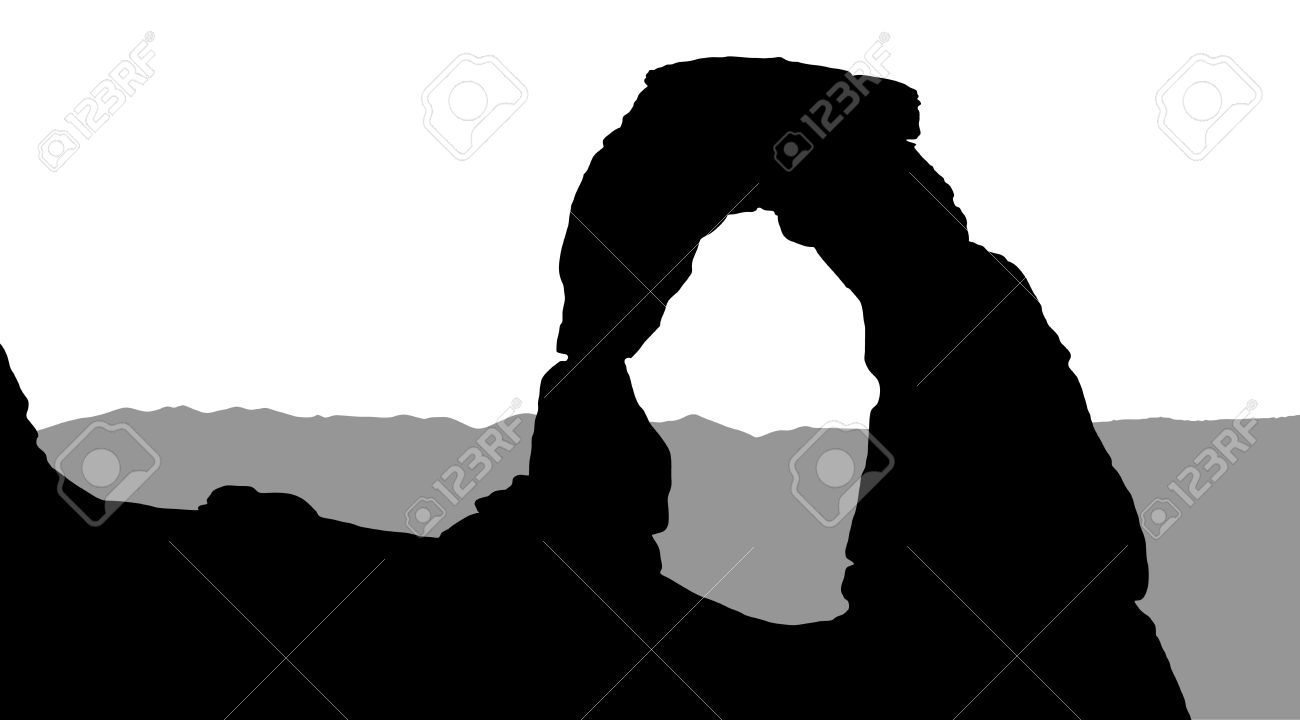 Silhouette of Delicate Arch with mountains in the background - 27361239