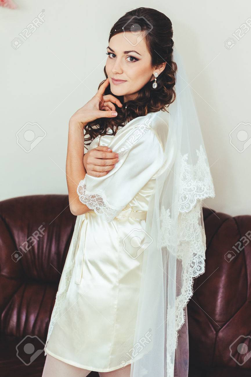 Bride Tries On A Wedding Dress Dressing Gown. Happy Beautiful ...