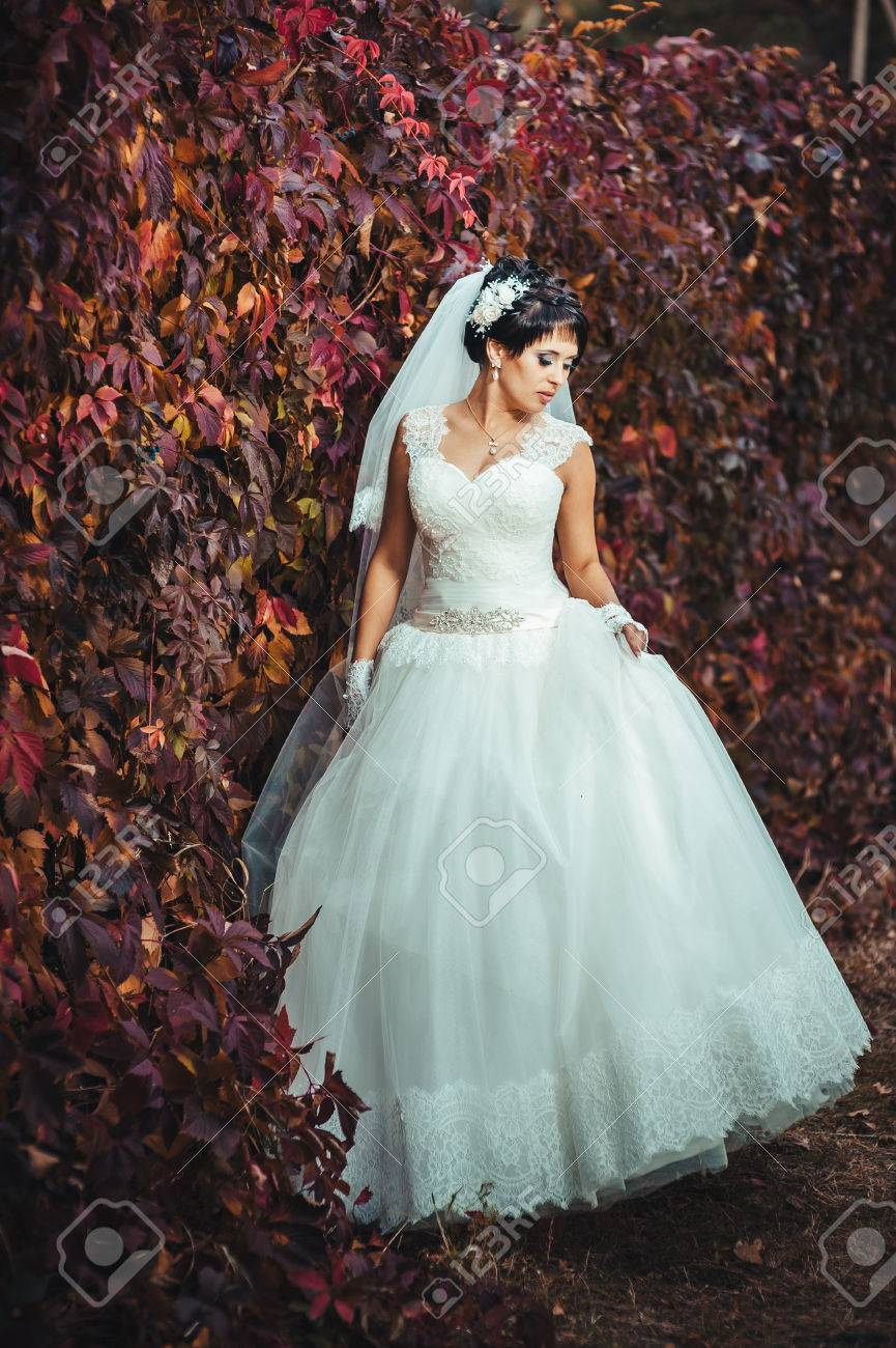 Portrait Of Beautiful Young Bride Holding Bright Bouquet Of Flowers ...