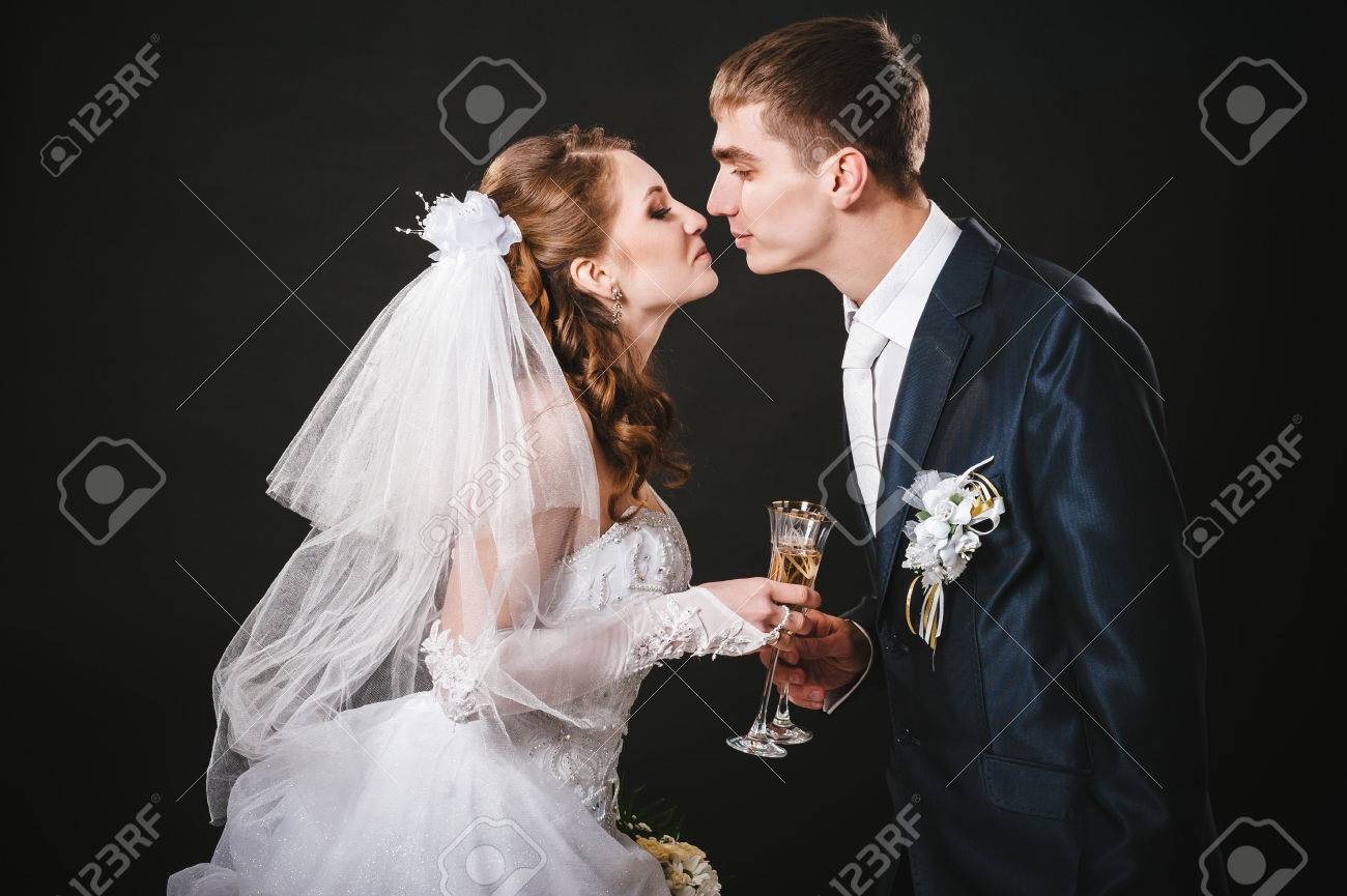Wedding Couple Kissing And Drinking Champagne Black Background
