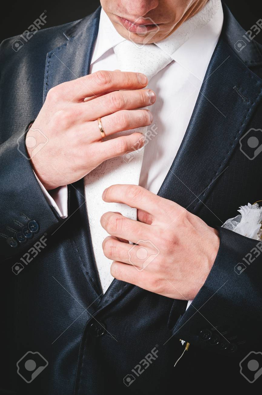 Hands Of Wedding Groom Getting Ready In Suit. Black Studio ...