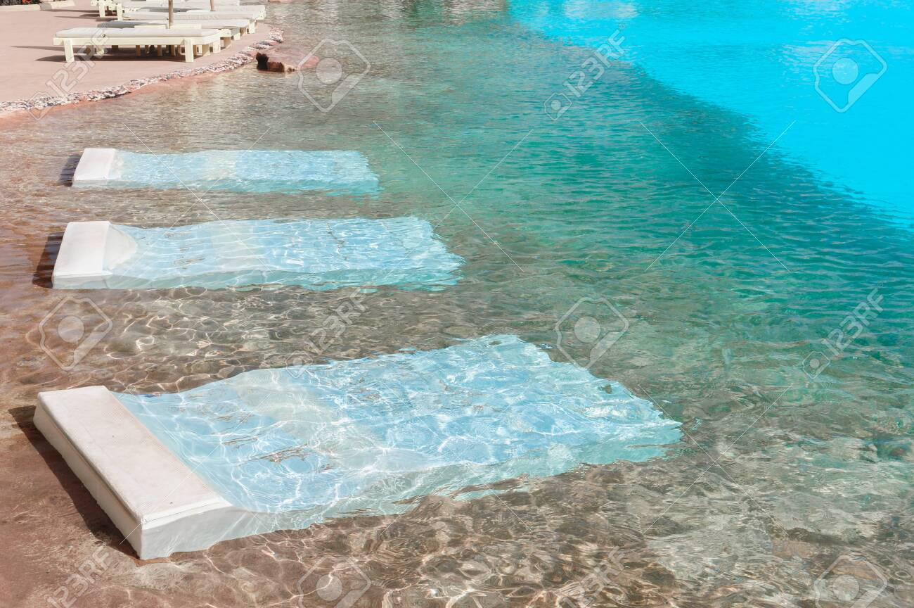 Swimming pool with beds for resting - 151947046