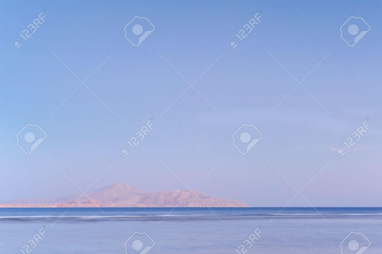 Soft sea ocean waves wash over golden sand background. Sunset, sunrise, sun. - 151310414