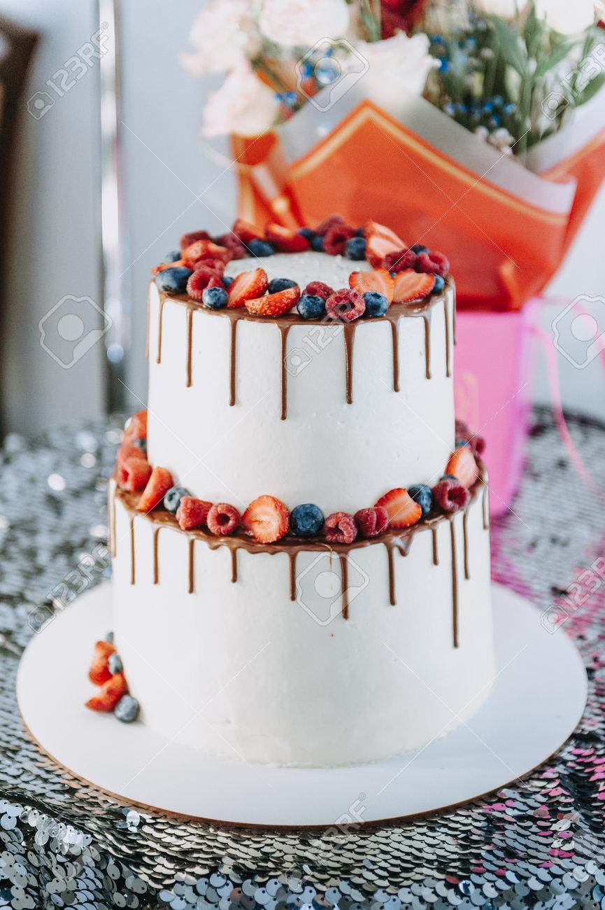 Chocolate cake with whipped cream and fresh berries. Close up. Sponge cake with strawberries and vanilla cream. - 168823255