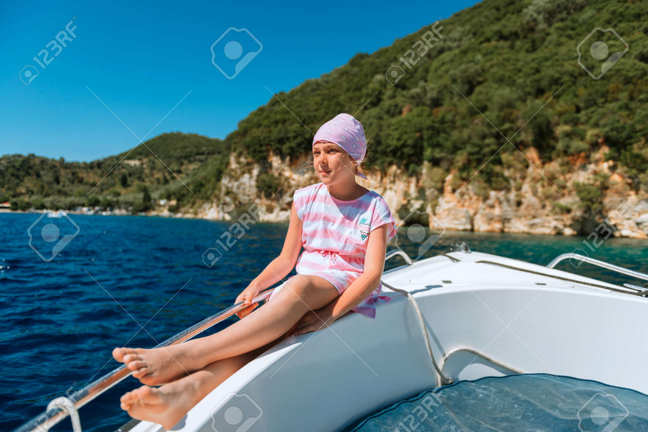 beautiful girl on speed boat in Greece. Little girl on a private yacht in the sea. Attractive young girl in posing on a yacht at a sunny summer day. - 168823489