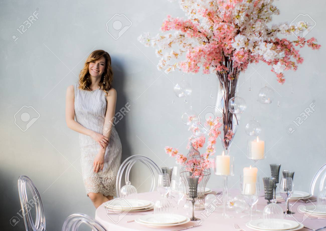 Smiling Bride Near The Wall And Wedding Decorations For Banquet ...