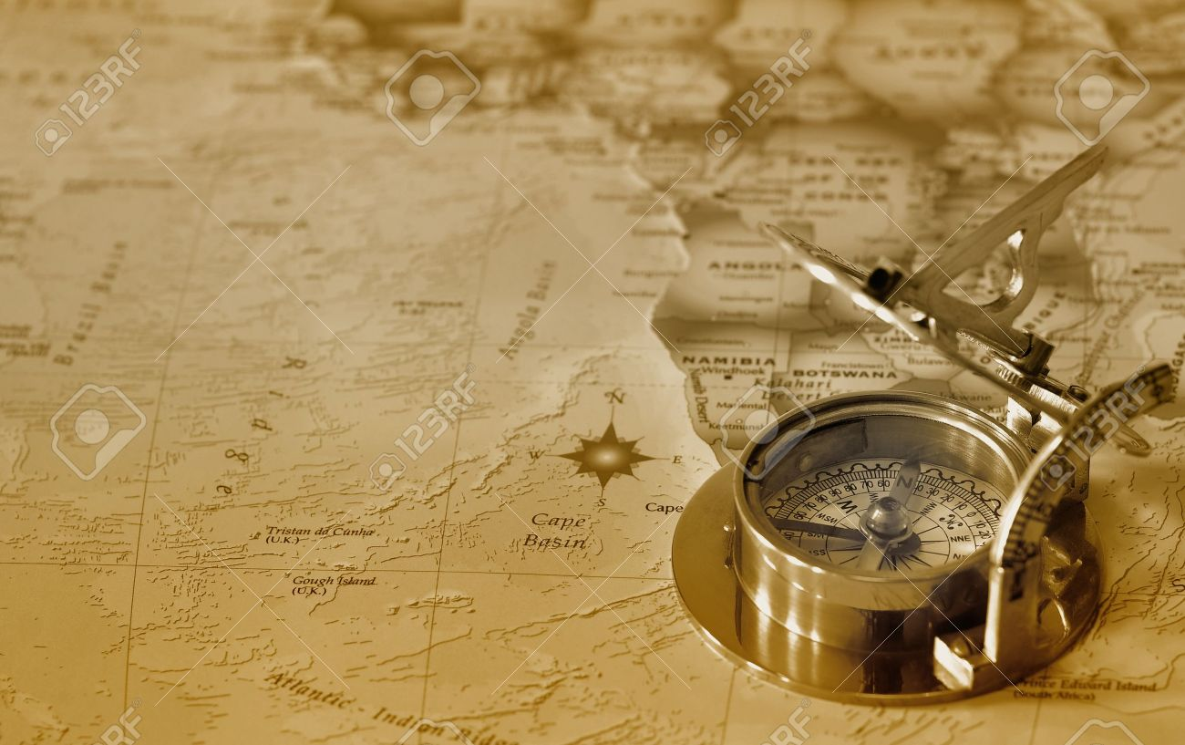 An old brass compass on a map background Stock Photo - 10813964
