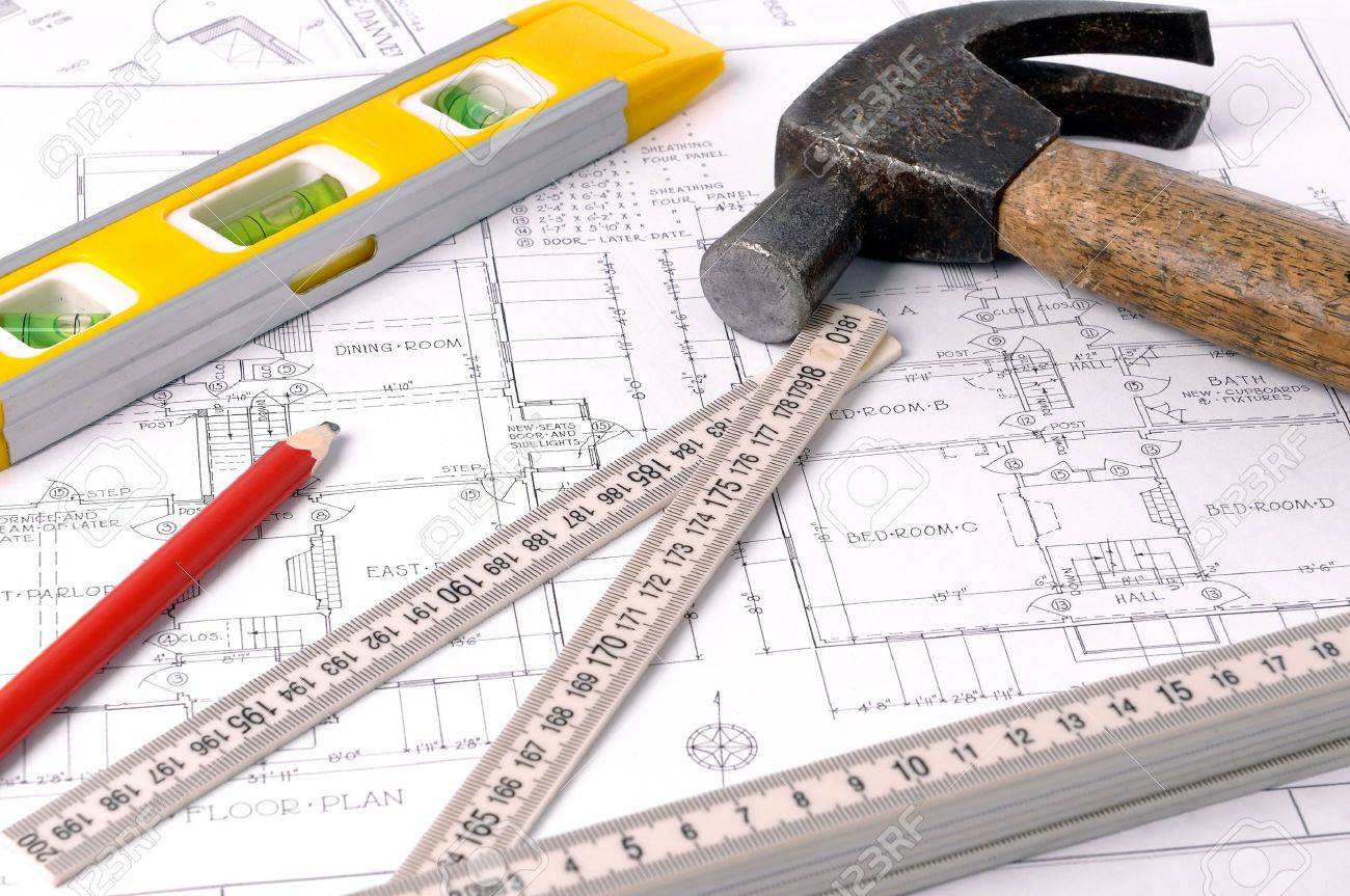 House blueprints, old hammer, pencil, level and measure Stock Photo - 12525311