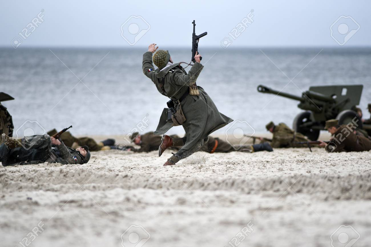 Soldiers fighting on the beach during the reconstruction of the