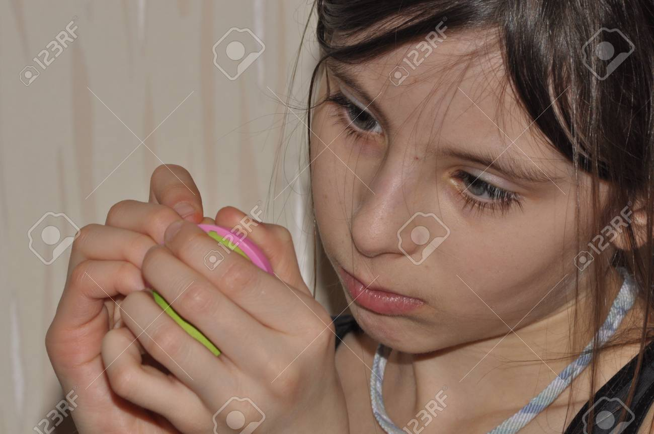Stock Photo The Girl A Child Doing Christmas Decorations Focus Handjob