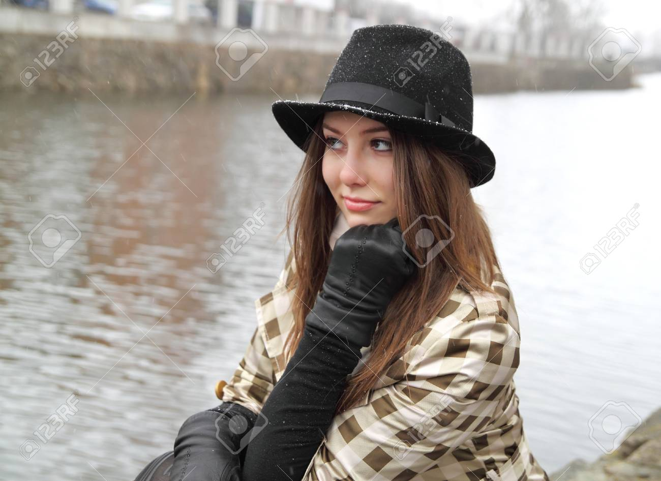 b6f8cc085f8 Woman in hat thinking in cold raining weather Stock Photo - 37859407