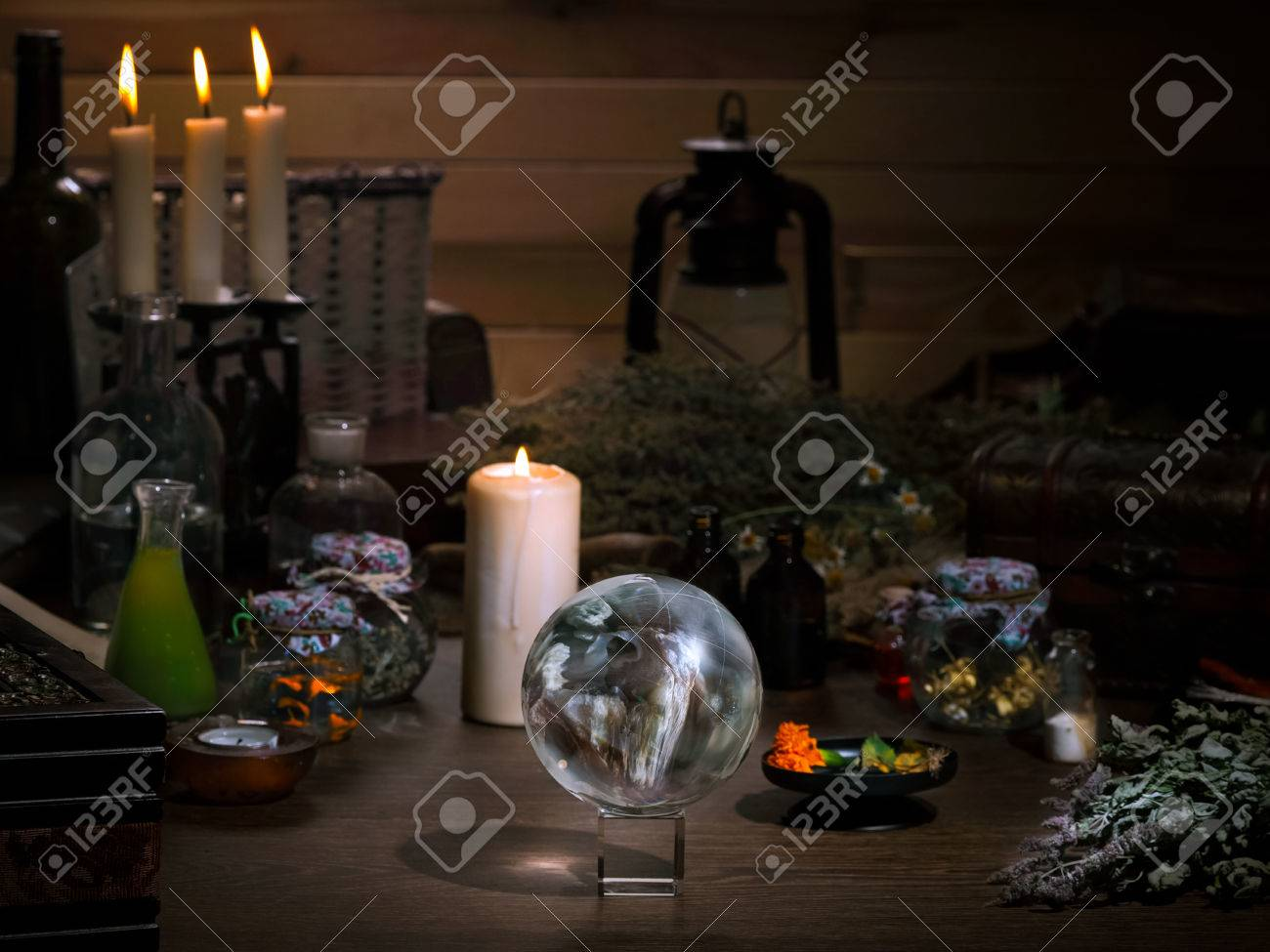 Mystical still life - the magic ball, candles, herbs. Many magic items and utensils alchemist. Concept - magic, witch board, alternative medicine, occult and witchcraft. Halloween - 61500371