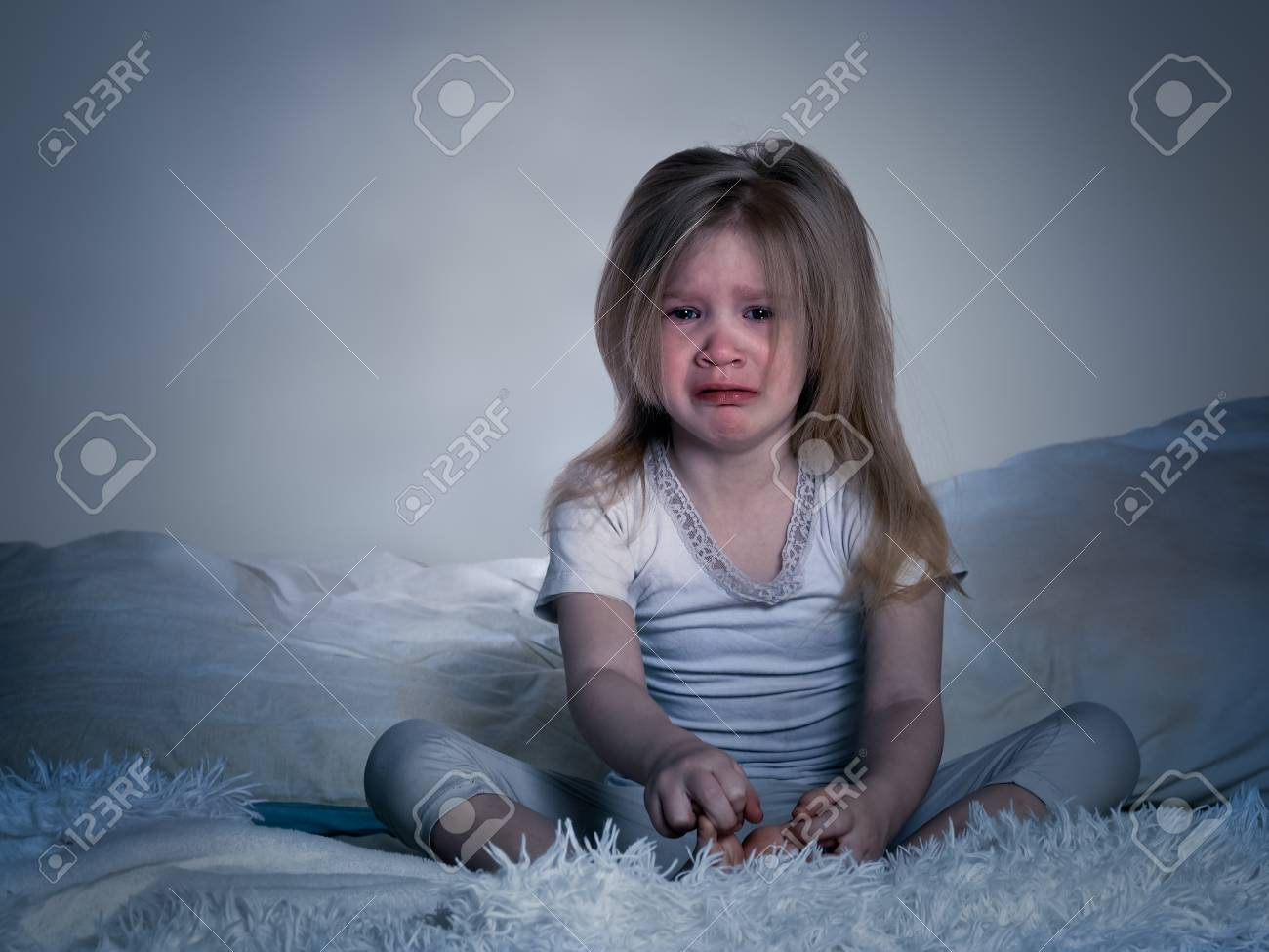 The baby is crying. A little girl in bed for the night - 73766720