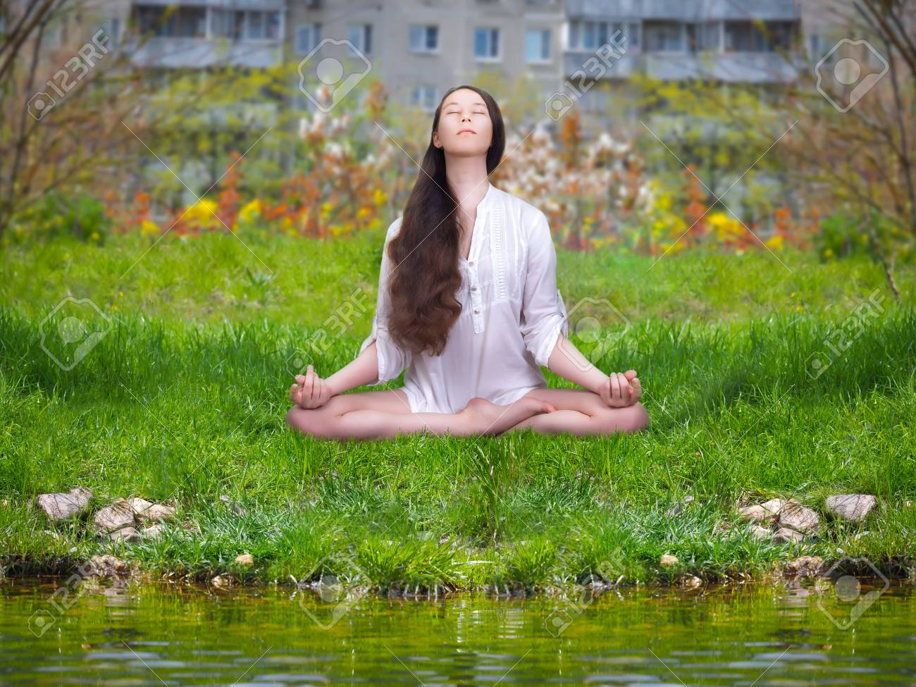 Beautiful Girl Is Engaged In Yoga Meditation On Nature In The Stock Photo Picture And Royalty Free Image Image 79110373