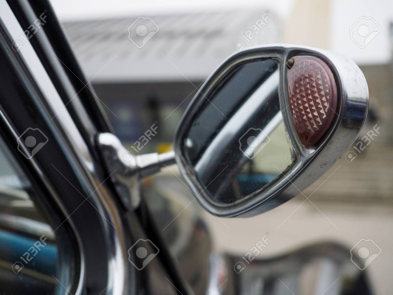 Old car mirror with turn indicator installed on the door