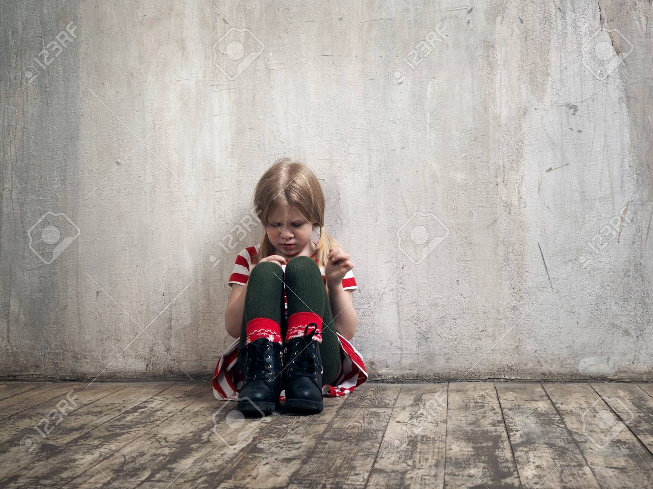 Sad little girl sitting on the floor. The concept of child psychology, loneliness, resentment - 93713678