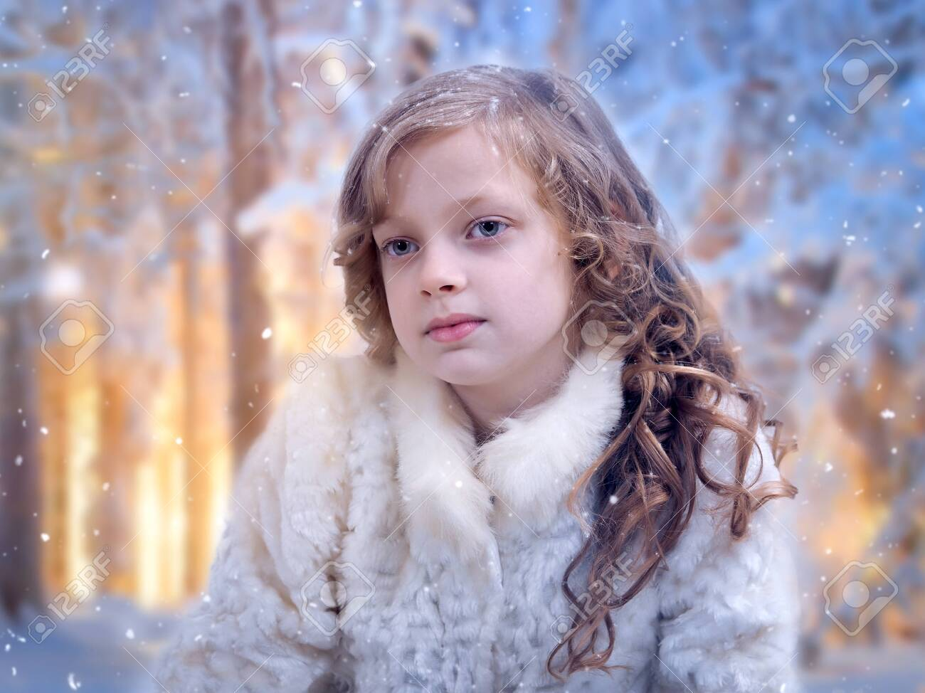 Very beautiful little girl under the falling snow - 135466940