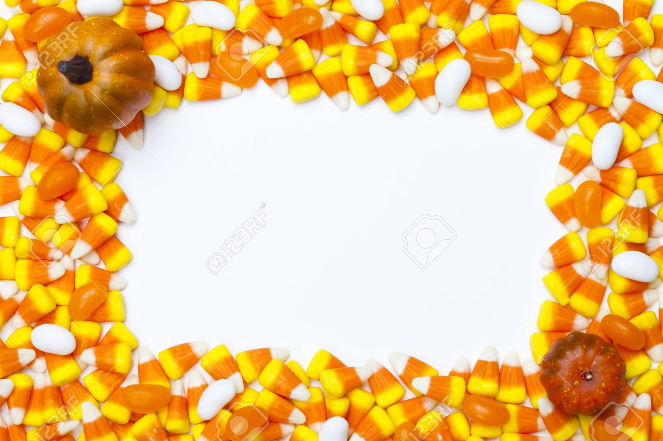 Close-up shot of arrangement of candy corns and pumpkins. Stock Photo - 15543174