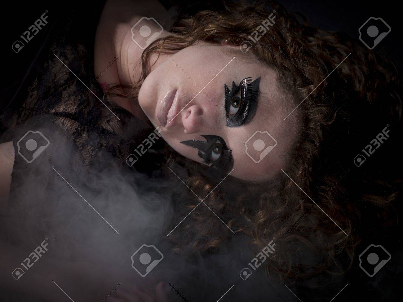 Gothic woman laying in fog Stock Photo - 15600300