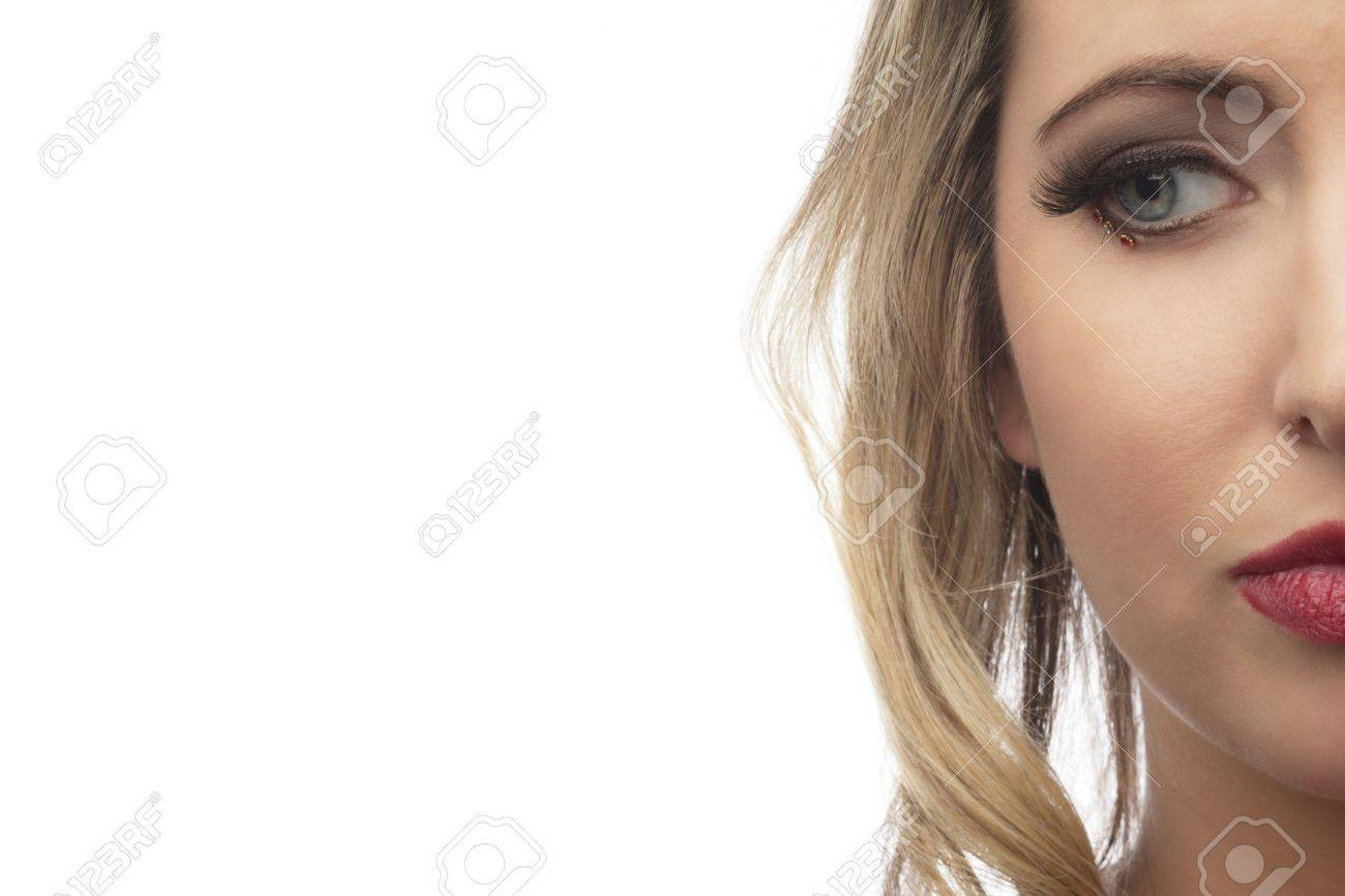 Close-up shot of half face of a attractive young woman over white background Stock Photo - 16967532