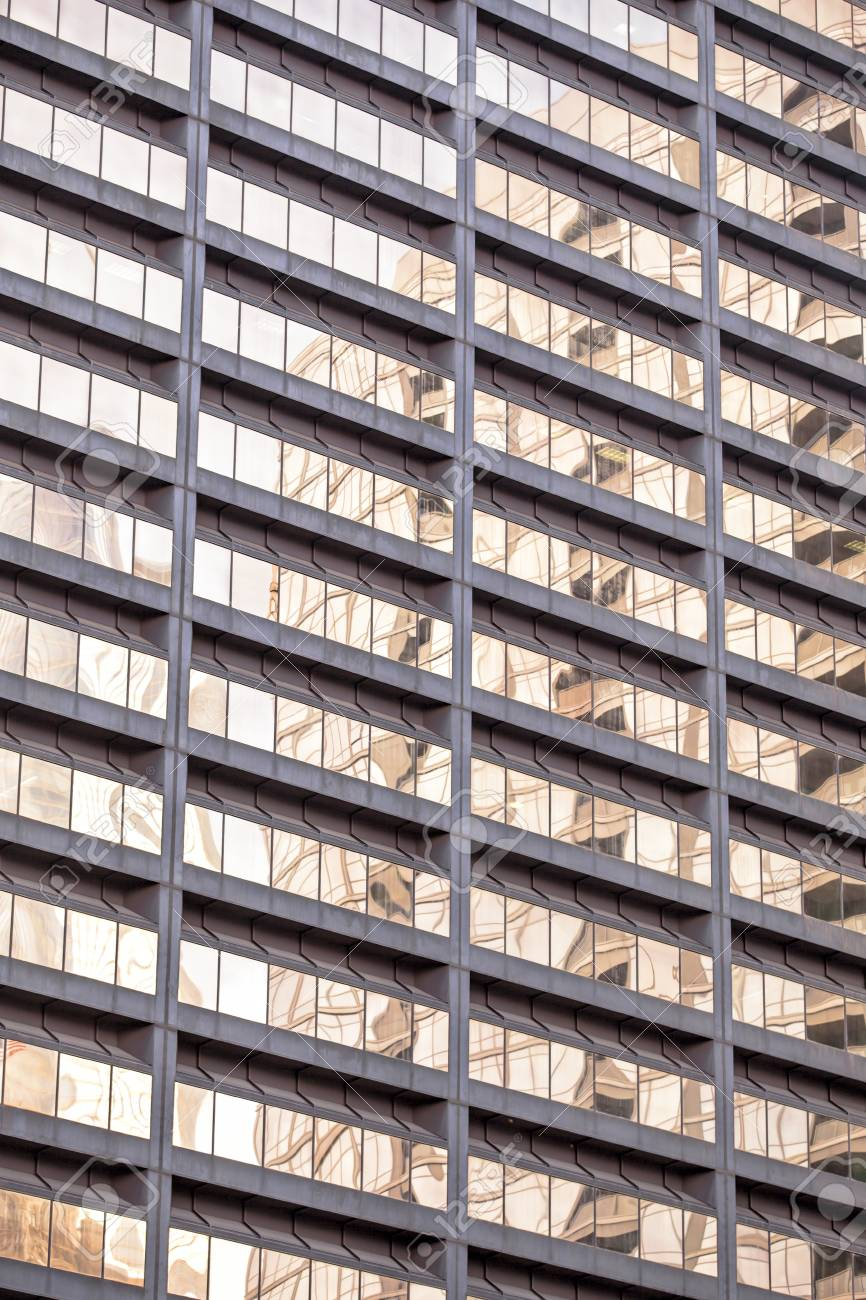 Low angle view of reflection on glass windows of a commercial building Stock Photo - 16973508