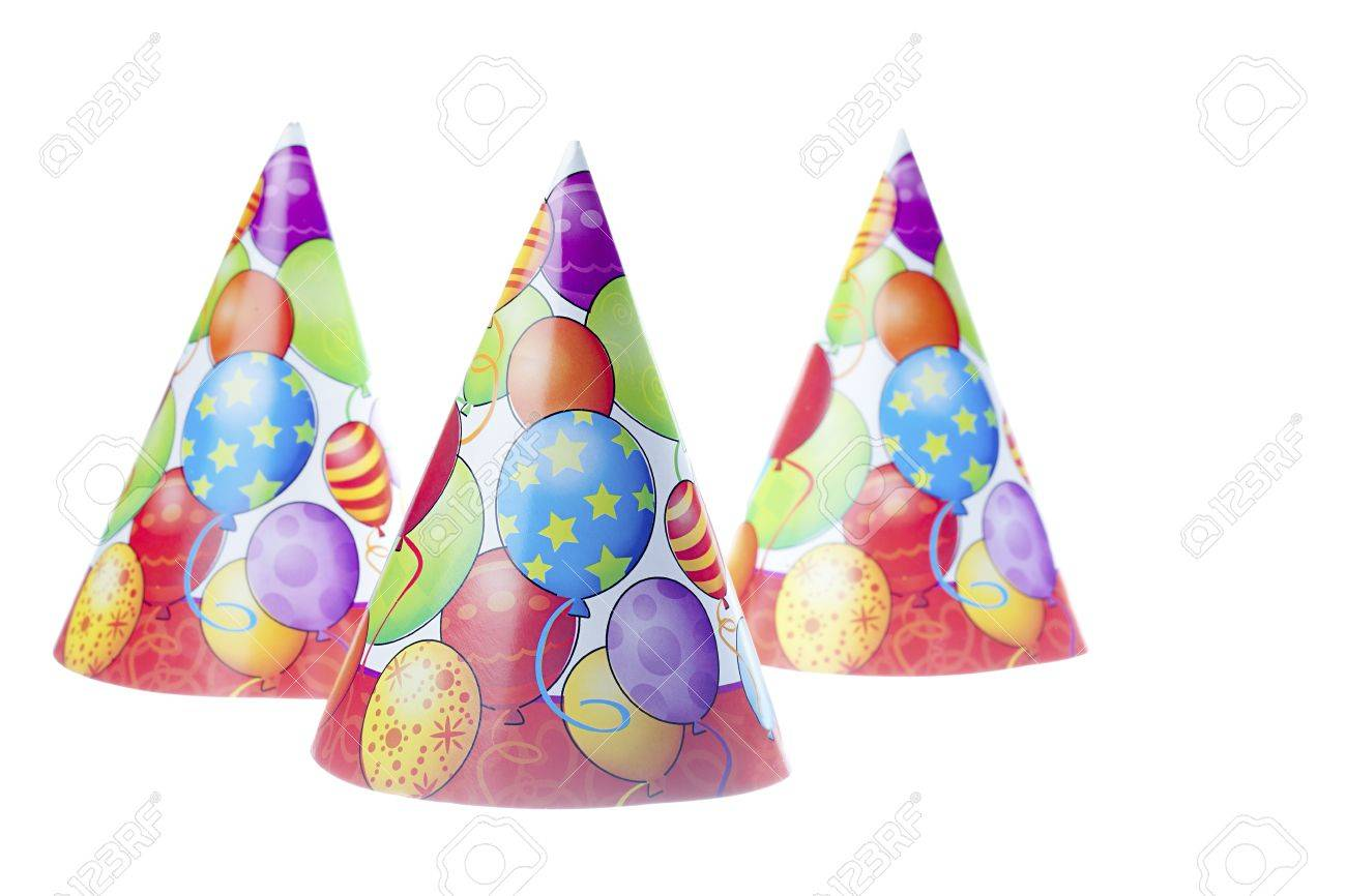 close up shot of three colorful birthday hats with balloons shape