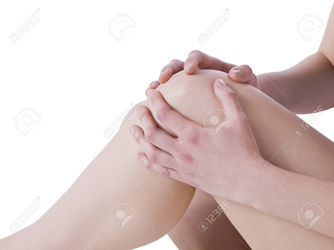 Closed up female holding her injured knee Stock Photo - 16995427