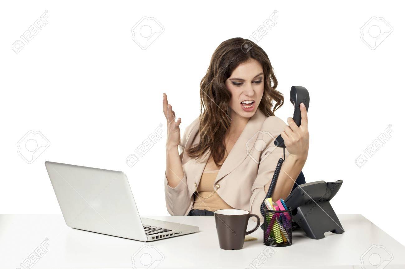 image of upset female office clerk yelling to the phone stock image of upset female office clerk yelling to the phone stock photo 16993064