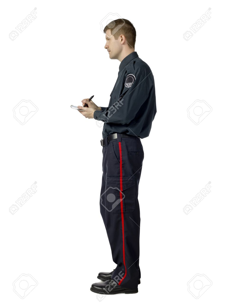 Side view image of a police officer writing notes against the white background Stock Photo - 17084131
