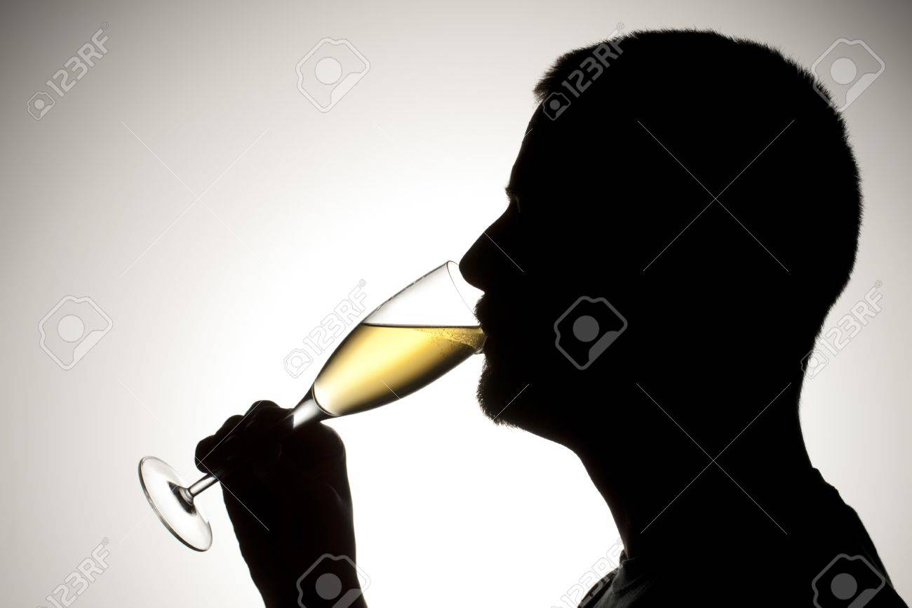 Silhouette of a man drinking a wine Stock Photo - 17134637