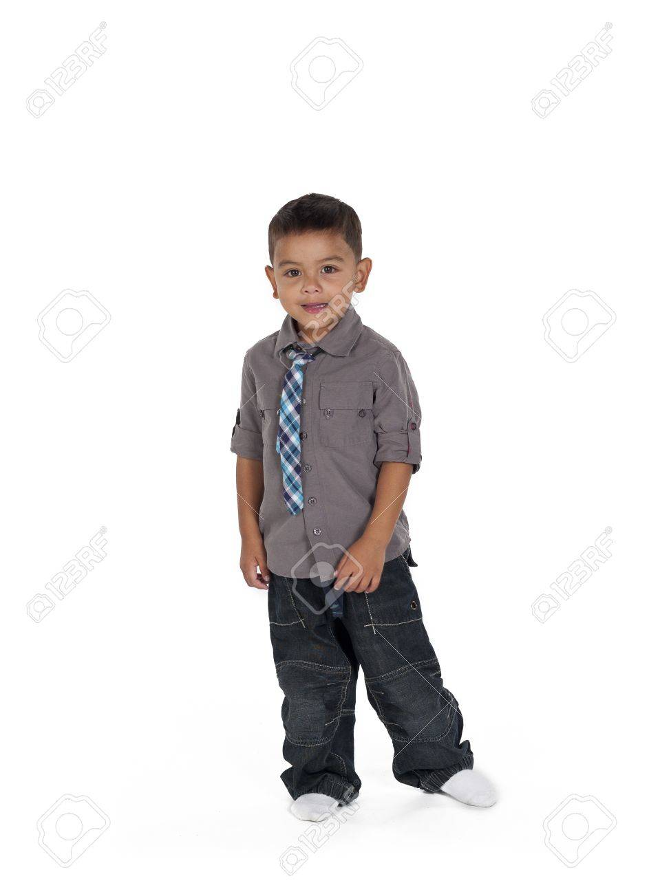 Portrait of a cute little boy with hands at side stock photo 17135039