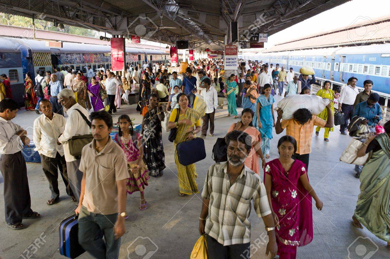 People at the train station in Mysore, India walking on the platform. Stock Photo - 17146566