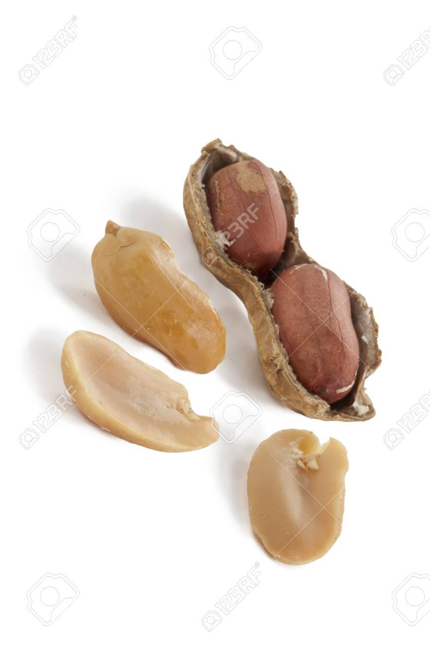 Cracked peanut and peeled nuts isolated in a white background Stock Photo - 17141361